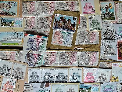 Pack of 80 used stamps, all from Pakistan, on paper