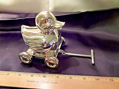 Reed & Barton Weighted Baby-Duck Bank On Wheels With Pull-Bar, Slight Gold Color