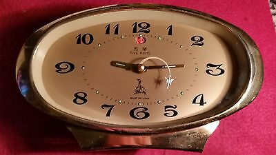 Chinese alarm clock with circling jet plane