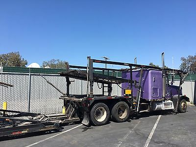1997 Peterbilt 377 with attached Cottrell 9-Car Carrier
