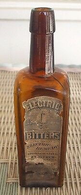 """Antique H.E. Bucklen, Chicago """"Electric Bitters"""" Amber Bottle with Both Labels"""