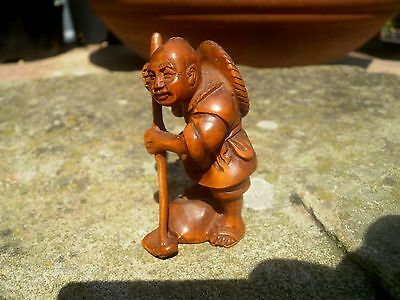Hand Carved wood netsuke farmer hoes ground vintage / antique style treen figure