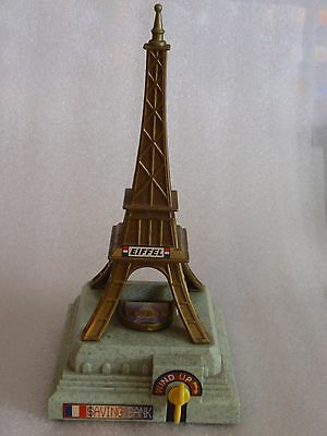 1997 Vintage Eiffel Tower Saving Bank Wind Up Mechanical Coin Flip Everlast Toys
