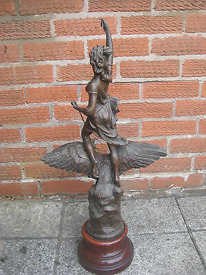 Pair of spelter figurines: La Nuit & Le Jour 28 inches high on wood bases