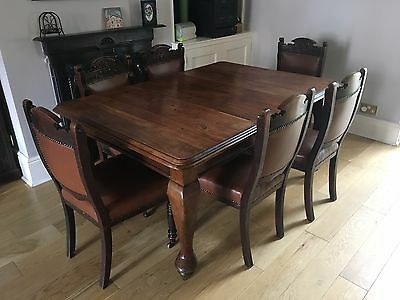 Original Victorian extending dining table and 6 leather-upholstered chairs