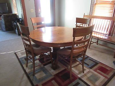 Oak Antique 4' round table and four chairs