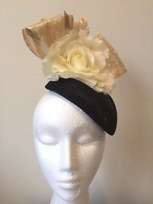 Stunning black air hostess fascinator with gold silk abaca loops and flower!