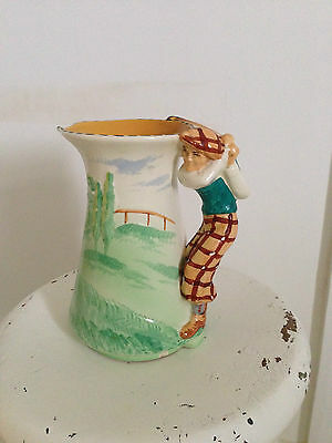 Burleigh wear jug depicting golf swing  1920s nice colours 20cms high approx