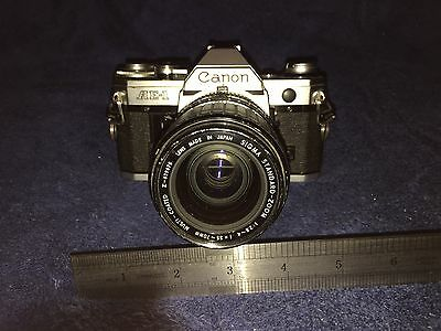 Vintage Canon AE-1 camera with SIGMA standard Zoom 35 - 70mm lens
