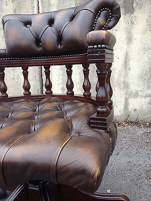 chesterfield captains chair in antique brown leather