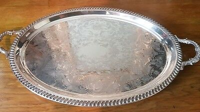 A beautiful large vintage silver plated tray stamped with 2 swords.very ornate.