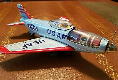 vintage tin friction powered USAF toy jet made by g.w made in Japan