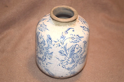 Old oriental stoneware pot with white and blue decoration