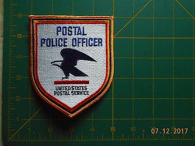 1 police patch   POSTAL OFFICER