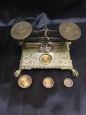Mint conidtion Antique brass posted scale with 3 weights