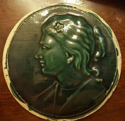 "Antique Tile. Woman's Silhouette with a Flower in her Hair. 4 1/2"" diameter"