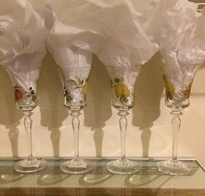 set of 4 Mikasa Belle Terre wine glasses. 2 never used, store sticker still on