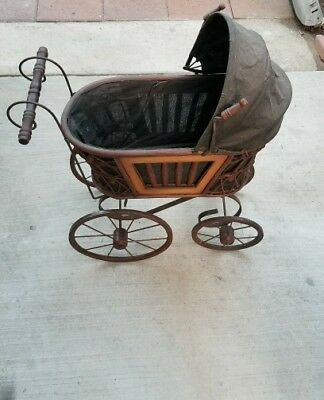vintage reproduction of antique baby stroller toy