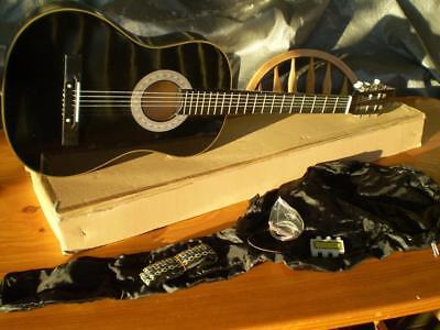 steel string accoustic guitar with strap spare stings pitch pipe soft bag & box