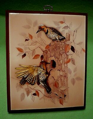Vintage colorful raised relief print on wood images of WOODPECKER'S at a nest.