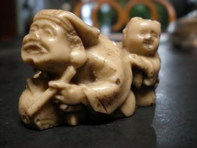 "Small Netsuke / Figurine - Man With Drum Child On Back - 2"" - Script On Bottom"
