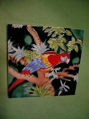 Perched MACAW PARROT art tile in vividly colored raised relief. Beautiful colors