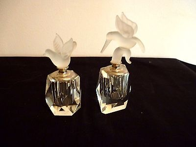 A Pretty Pair Of Crystal Perfume Bottles With Frosted Bird Tops