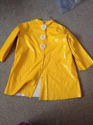 Rain coat, yellow, pre-owned, used as a dance costume