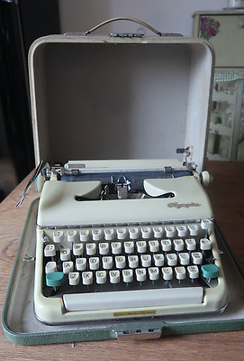 1963 Olympia SM5 Portable Manual Typewriter with Original Head Brush