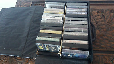 26 music cassette tapes and holder