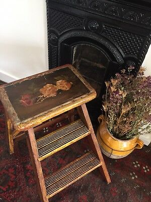 Vintage display step ladder with oil painting