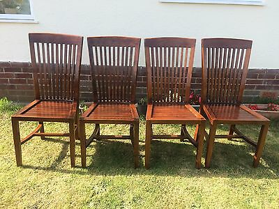 A set of 4 quality real solid oak high back dining chairs