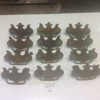 Set of 12 old repoduction brass plated drawer pulls screw holes 2.5 in.