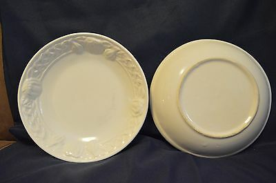 Two White Ceramic Bowls With Green Metal Basket And White Cloth Napkin