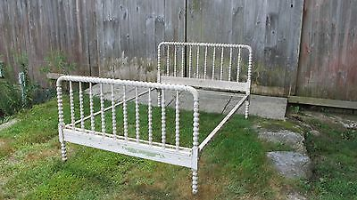 vintage Jenny Lind spindle bed with wooden rollers