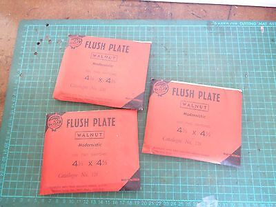 Vintage electrical fittings, orig packs. 3 x walnut flush plates 4.5 x 4.5 ins