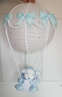 Hot air balloon light shade + blue monkey comforter  looks stunning nursery baby
