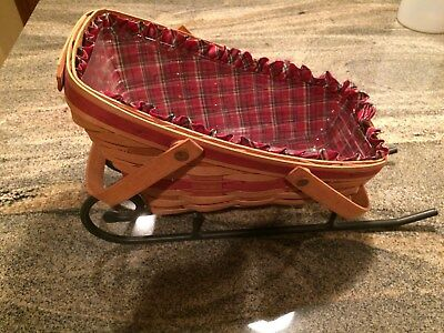 Longaberger basket and wrought iron sleigh -- 1991 Yuletide Traditions