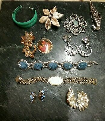 11 piece lot of vintage earings, brooches,bracelets and pendants.