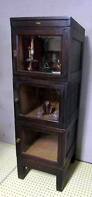 antique Globe stacking bookcase physician's cabinet