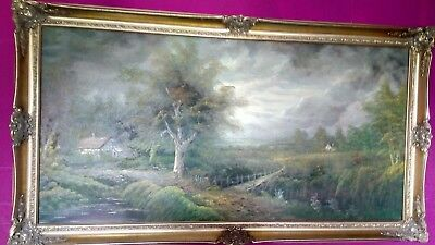 large landscape oil painting on canvas set in gold gilt frame