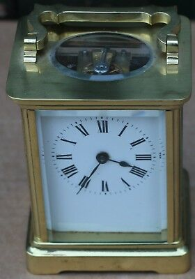 Small Very Clean Looking Brass Carriage Clock With Bevel Edged Glass Panels
