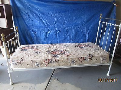 Antique white Iron Day Bed. Heavy with removable casters.Brand new mattress