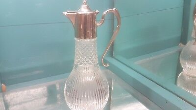 A beautiful vintage silver plated/cut glass claret jug.very ornate.