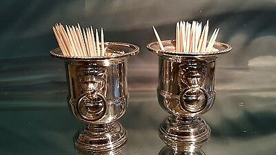 A pair of beautiful silver plated cocktail stick holders.very ornate.sheffield.