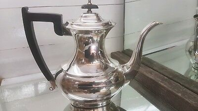 A very ornate vintage silver plated tea pot by viners of sheffield
