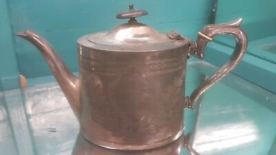 A very old antique silver plated tea pot by j.dixon & sons of sheffield.