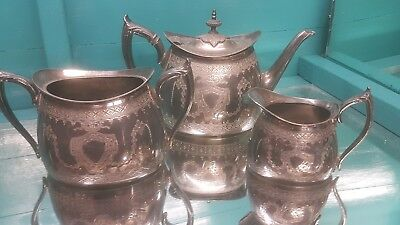 An antique silver plated tea set with engraved patterns.p.ashberry.sheffield