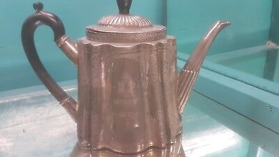 An antique silver plated tea pot by mappin & webb with engraved patterns.