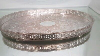 A beautiful vintage silver plated gallery tray with elegant patterns.ornate.